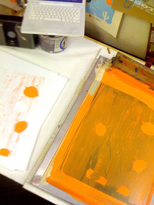 First color, orange, being printed.